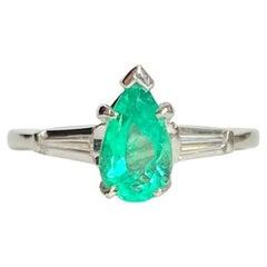 Vintage Emerald and Diamond Platinum Solitaire Ring