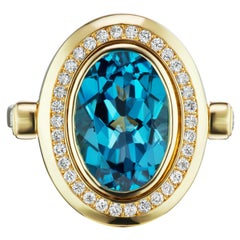 14k Solid Gold Cocktail Ring in London Blue Topaz with Diamond Halo
