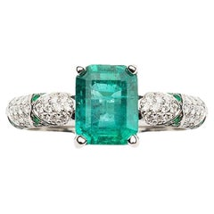 Lotus Emerald Solitaire Center with Emerald Petals and Pave Diamond Ring