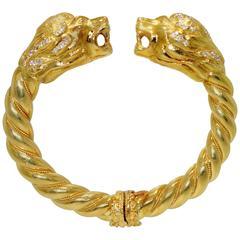 Lion's head gold bangle bracelet