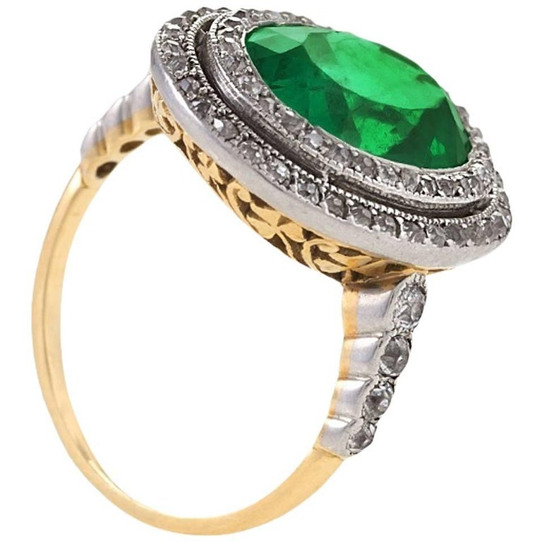 Colombian Emerald and Diamond Halo Ring  For Sale