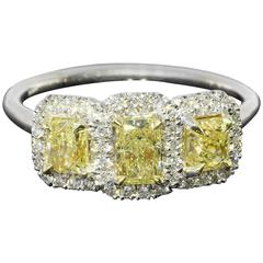 1.16 Carats Yellow Radiant Diamonds Halo Two Color Gold Three Stone Ring