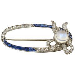 Art Deco Sapphire Moonstone Diamond Platinum Open Oval Bow Brooch Pin