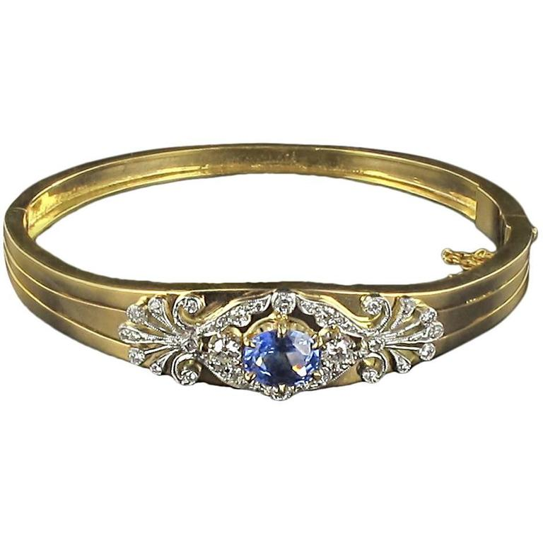 Gold bangle bracelet set with diamonds and sapphire