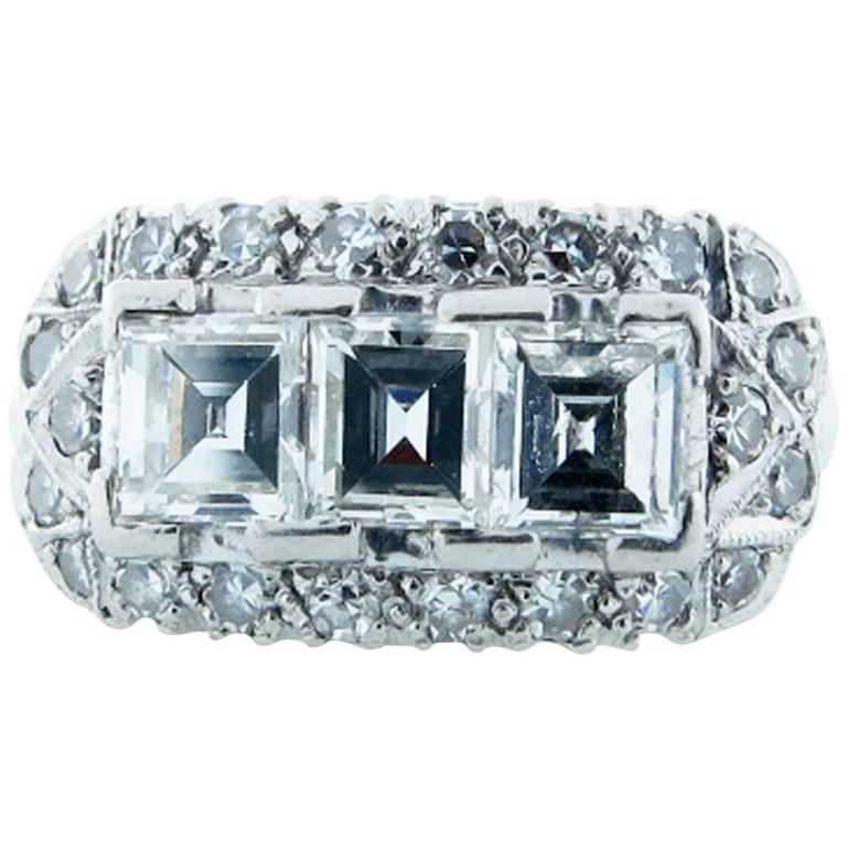 Exquisite Art Deco Three Stone Emerald Cut Diamond Platinum Ring