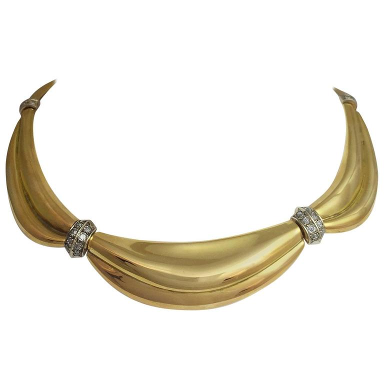 1950s Gold Drapery necklace with intercalary set with diamonds