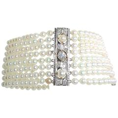 Early 20th Century Pearl Diamond Gold Platinum Bracelet