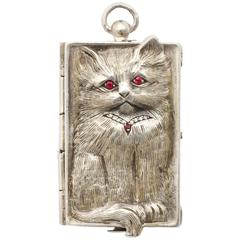 Silver Pendant of a Cuddlesome Kitty with Ruby Eyes