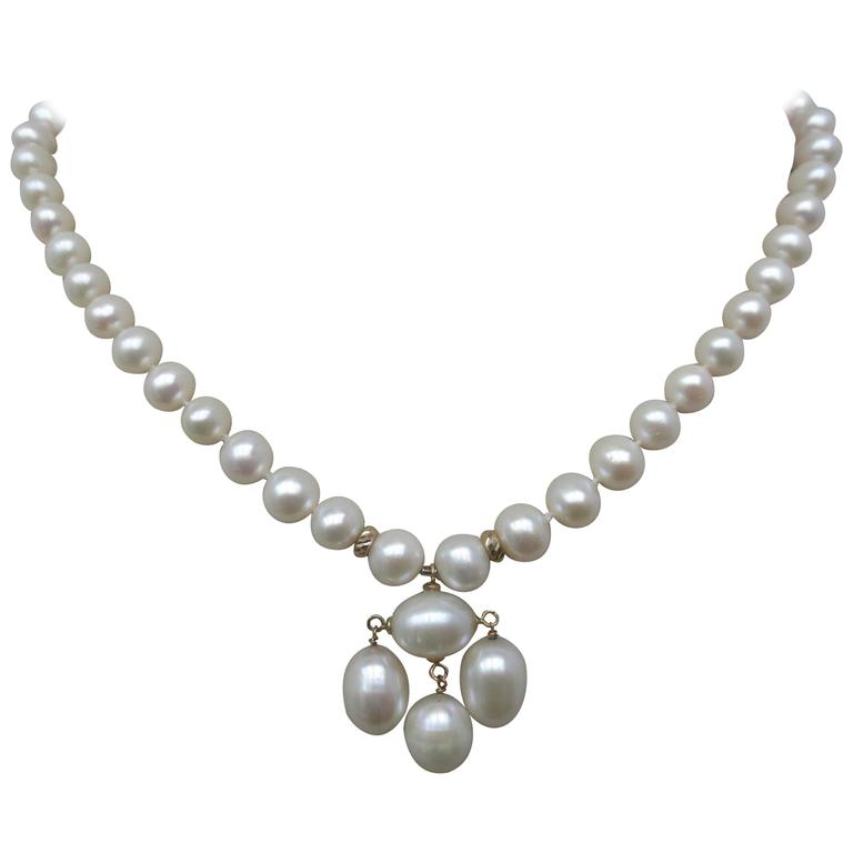 Round Pearl Necklace with Baroque Pearl Centerpiece and Gold Findings 1
