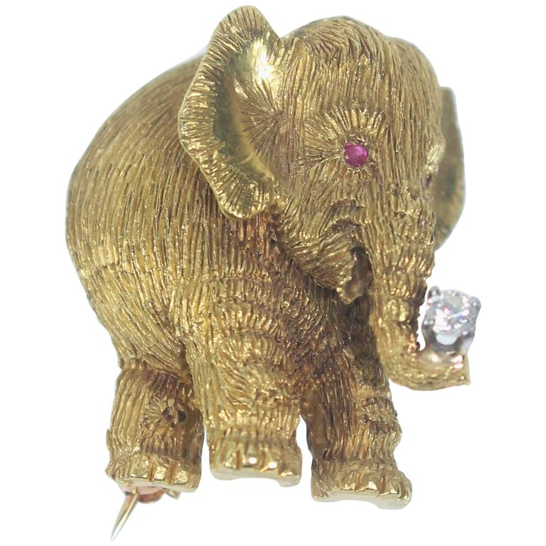 Gold elephant pendant or pin with diamond trunk and ruby eyes at 1stdibs gold elephant pendant or pin with diamond trunk and ruby eyes for sale aloadofball Gallery