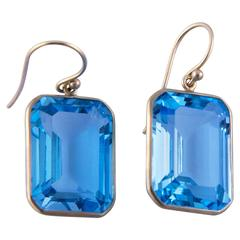 Contemporary Emerald Cut Blue Topaz Gold Drop Earrings
