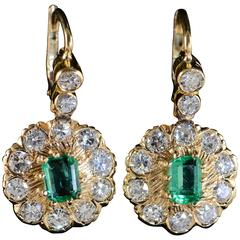 1.50 Carats Emeralds 2.80 Carats Old Mine Cut Diamonds Gold Earrings
