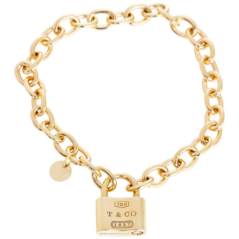 46c279c7e Tiffany and Co. Gold 1837 Padlock Charm Chain Link Bracelet at 1stdibs