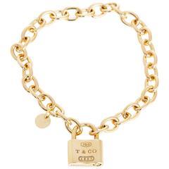 Tiffany & Co. Gold 1837 Padlock Charm Chain Link Bracelet