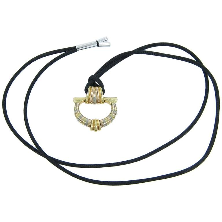Cartier Aurore Tri Color Gold Ribbed Pendant with Silk Cord