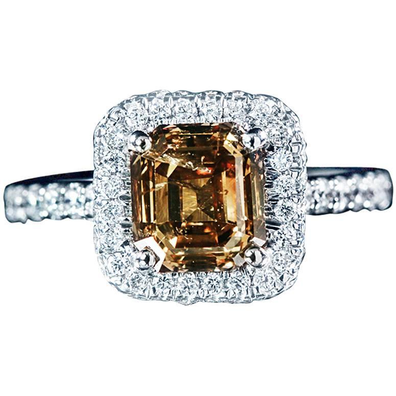 brown emerald cut halo pave set engagement ring at