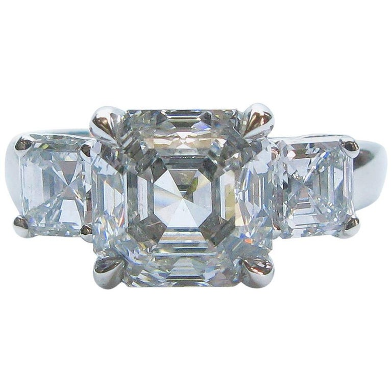 3.01 Carat GIA F VS1 Certified Asscher Diamond Platinum Three Stone Ring For Sale