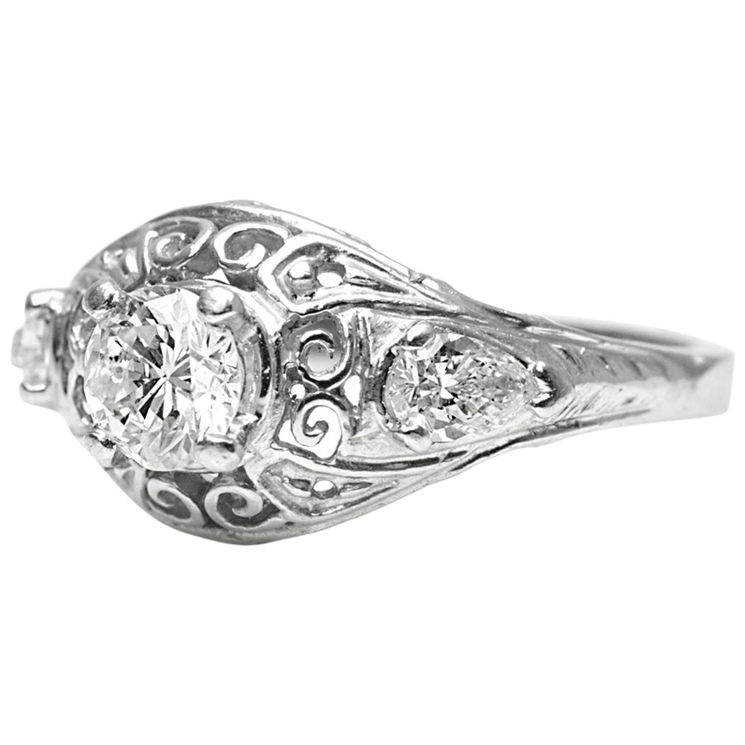 1930s Round and Pear Shaped Diamond Platinum Engagement Ring For Sale at 1stdibs