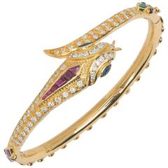 14k Snake Bracelet, with Diamonds,  Emeralds,  Rubies and Sapphires