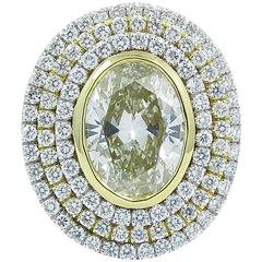 3.12 Carat Fancy Color Oval Diamond Gold Triple Halo Ring