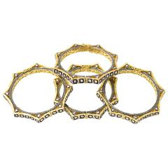 Collection of Four Diamond and Vermeil Bangle Bracelets