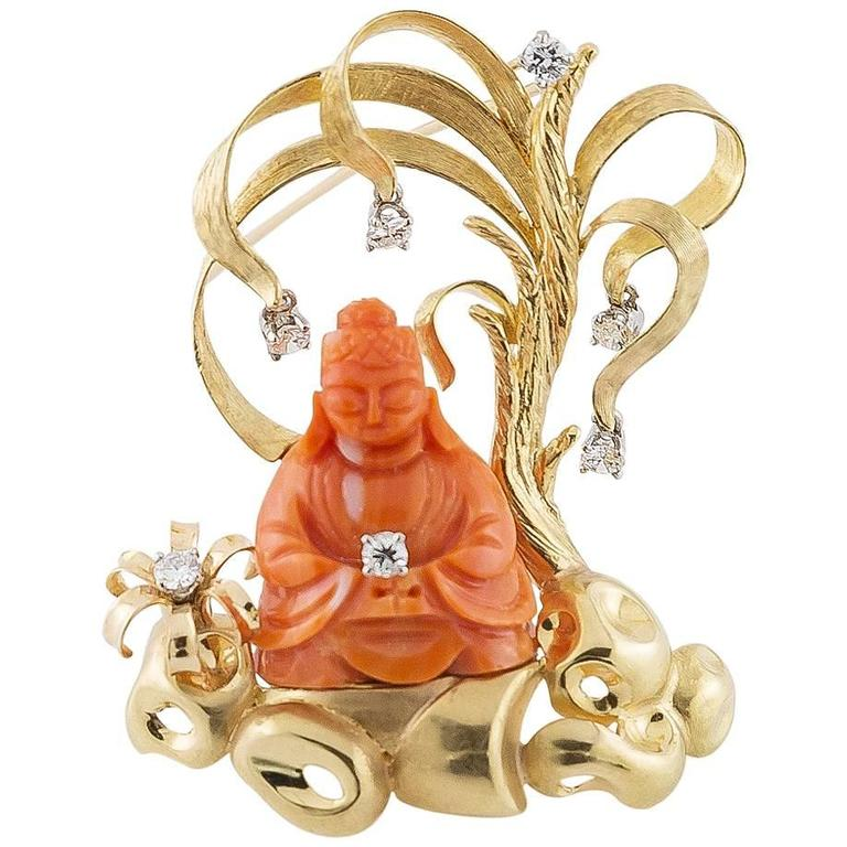 70's Buddha Brooch Carved in Coral set in Gold with Diamonds