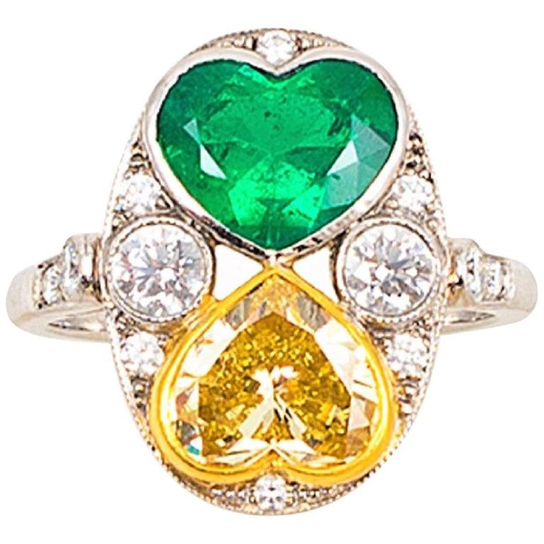 1.75 Carat Fancy Yellow Diamond and Emerald Hearts Platinum Ring