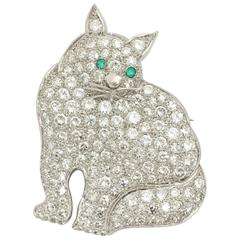 1930s Emerald Diamond Platinum Figural Green-Eyed Kitty Cat Brooch