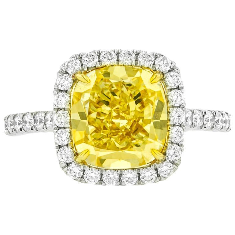 Fancy Yellow 4.77 Carat Diamonds Gold Ring