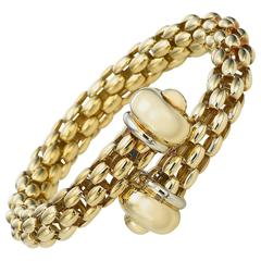 Italian Two Color Gold Bypass Cage Style Bracelet