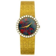 Piaget Ladies Yellow Gold Diamond Bezel Opal Dial Wristwatch