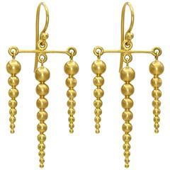 Golden Sphere Satin Finish Dagger Drop Earrings