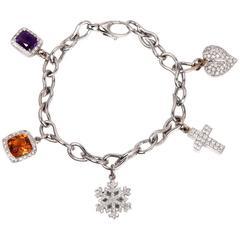 Multi-Gem Diamond Gold Charm Bracelet With Diamond Snow Flake and Cross