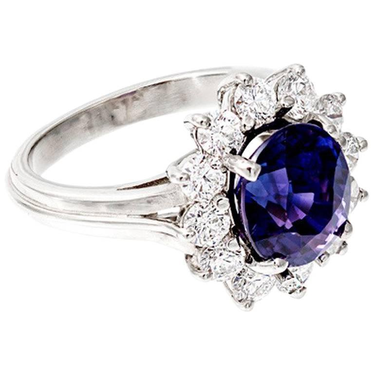 Oval Blue Purple Sapphire Diamond Halo Engagement Ring For