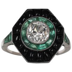 1930s Art Deco 1.20 Carat Old Cushion Cut Diamond Emerald Gold Halo Ring