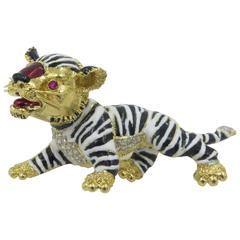 A Whimsical Enamel Diamond Gold Tiger Brooch