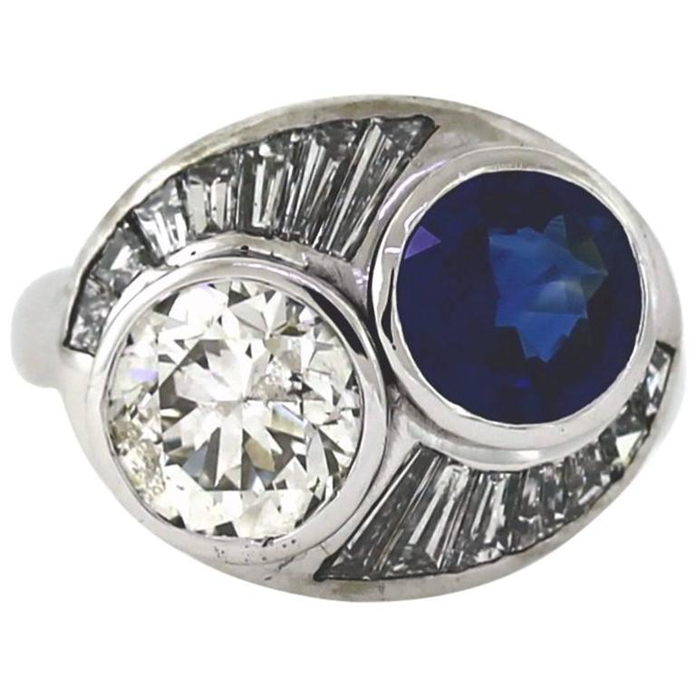 2.50 Carat Round Sapphire 2.19 Carat Diamond Gold Bypass Ring For Sale