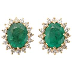 Oval Emerald Diamond Gold surround Earrings