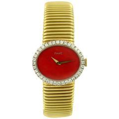Piaget Ladies Yellow Gold Diamond Coral Dial Tubogas Bracelet Wristwatch