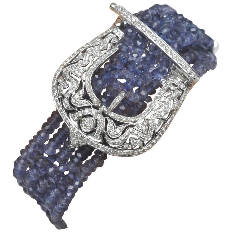 Faceted Beaded Tanzaniate and Diamond 18 Karat Gold Five Strand Buckle Bracelet