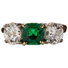 1.09 Carat Emerald Diamond Gold Three Stone Ring