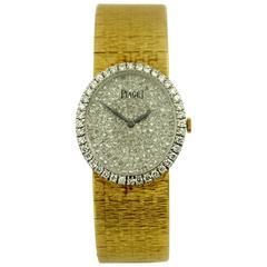 Piaget Ladies Yellow Gold Pave Diamond Dial Diamond Bezel Wristwatch