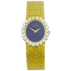 Piaget Ladies Yellow Gold Diamond Bezel Lapis Dial Wristwatch