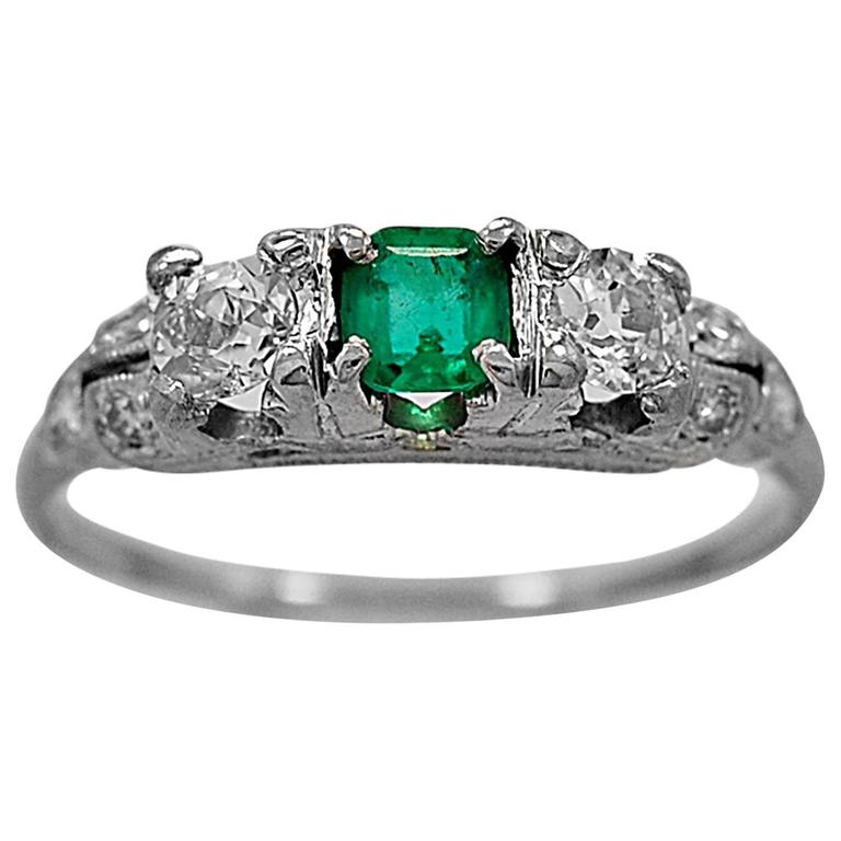 Antique Emerald Diamond Platinum Engagement Ring For Sale at 1stdibs