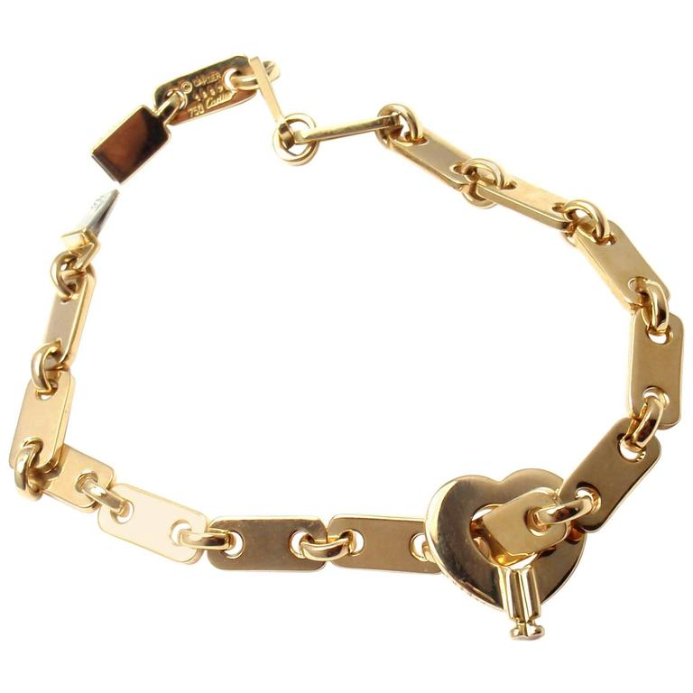 cartier locking bracelet cartier gold lock charm link bracelet at 1stdibs 5085