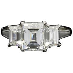 An Elegant 3.63 Carat Three Stone Step-Cut Diamond And Platinum Ring By Hancocks