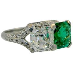 Art Deco Dreicer & Co. Emerald Diamond Platinum Twin Ring