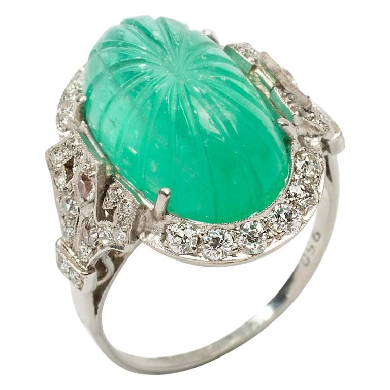 Platinum Ring with Carved Emerald and Diamonds For Sale