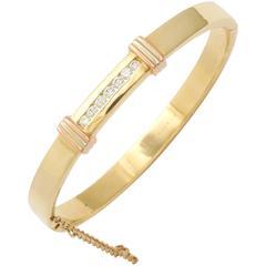 1980s Cartier New York Diamond Gold Hinged Bangle Bracelet