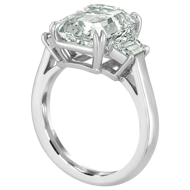 6.02 Carat Emerald Cut Diamond Set in Platinum with Trapezoids For Sale